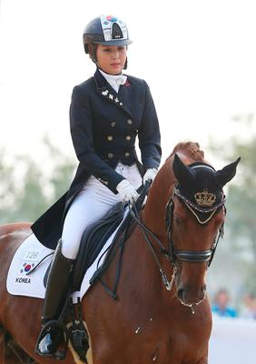 South Korea's Chung Yoo-ra, the daughter of Choi Soon-sil, the confidante of disgraced President Park Geun-hye, competes during the equestrian dressage team competition for the 17th Asian Games in Incheon, South Korea. (Lee Sang-hak/Yonhap via AP)