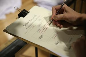 A tally keeper at work as votes are counted (Brian Lawless/PA)
