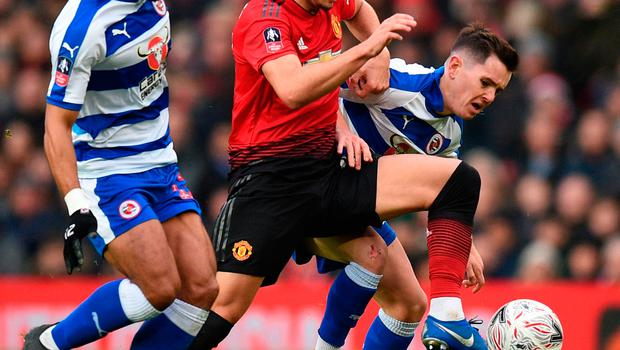 Andreas Pereira (C) battles with Reading's Yakou Meite (L) and Liam Kelly (R)