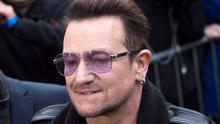 U2 lead singer Bono arrives for the recording of the Band Aid 30 charity single in west London November 15, 2014. Singers came together to record a new version of the Band Aid charity song to raise money to combat Ebola in Africa (REUTERS/Neil Hall)