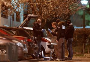 Police investigators search for evidence during an operation in the eastern French city of Reims January 8, 2015, after the shooting against the Paris offices of Charlie Hebdo, a satirical newspaper. REUTERS/Christian Hartmann