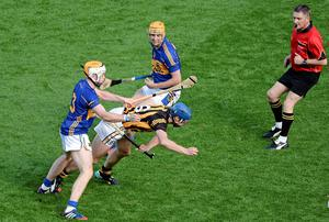 Referee Barry Kelly judges that Kilkenny's Brian Hogan committed a foul in the dying moments of the All-Ireland hurling final at Croke Park, resulting in a free for Tipperary. Photo: Dáire Brennan / SPORTSFILE