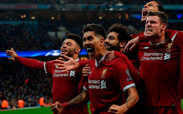 Liverpool's Brazilian midfielder Roberto Firmino celebrates scoring his team's second goal during the UEFA Champions League second leg quarter-final football match between Manchester City and Liverpool, at the Etihad Stadium