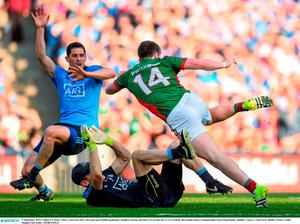 5 September 2015; Cillian O'Connor, Mayo, scores his side's first goal past Dublin goalkeeper Stephen Cluxton and Rory O'Carroll, left. GAA Football All-Ireland Senior Championship Semi-Final Replay, Dublin v Mayo. Croke Park, Dublin. Picture credit: Stephen McCarthy / SPORTSFILE