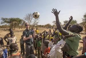 CEO of Goal Barry Andrews playing football with children in the Twic County of South Sudan