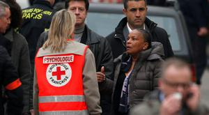 French Justice minister Christiane Taubira (right) stands near the Paris offices of Charlie Hebdo January 7, 2015 after a shooting. Reuters/Charles Platiau
