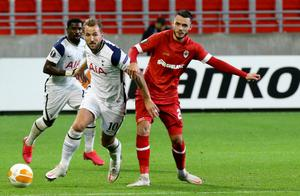 Tottenham's Harry Kane, battles for the ball with Royal Antwerp's Jeremy Gelin. Photo: AP