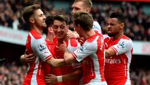 Arsenal's Mesut Ozil celebrates after scoring his side's second goal in their win over Liverpool. Photo: BEN STANSALL/AFP/Getty Images