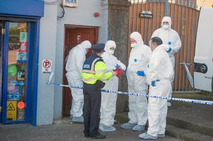 Garda forensic officers analyse the scene. Photo: Michael MacSweeney