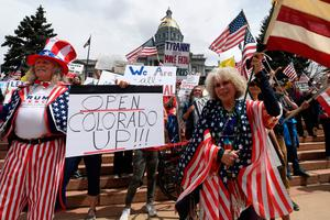 Protestors demonstrate against new safer-at-home orders during the End the Lockdown Now rally at the Colorado Capital in Denver, Colorado. (Photo by JASON CONNOLLY/Agence France-Presse/AFP via Getty Images)