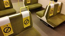 Posters have been placed on train seats to maintain physical distancing. Credit: Irish Rail