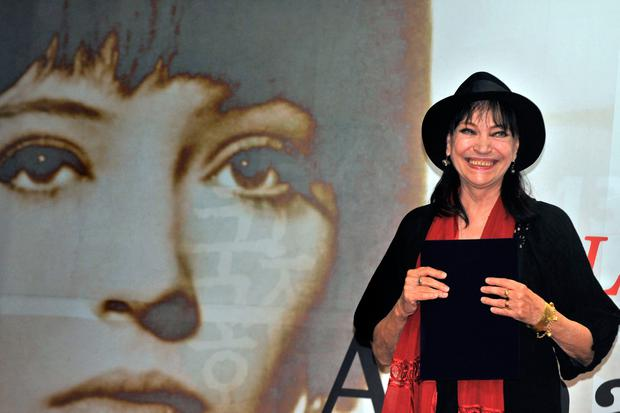 In this file photo taken on October 08, 2008 Danish born actress Anna Karina smiles during the 13th Pusan International Film Festival in Busan on October 8, 2008. (Photo by KIM JAE-HWAN / AFP) (Photo by KIM JAE-HWAN/AFP via Getty Images)