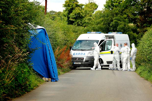 Forensics examine where the body was found