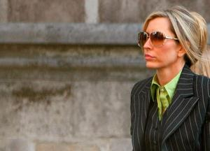 Heather Mills arrives to the High Court on February 13, 2008 in London, England. Sir Paul McCartney and Heather Mills are attending the third day of a hearing to reach a financial settlement for their divorce.  (Photo by Daniel Berehulak/Getty Images)