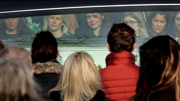 Mourners in tears outside the Church of the Holy Family. Photos: Gerry Mooney