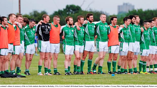 20 June 2015; London players stand for a minute's silence in memory of the six Irish students that died in Berkeley, USA. GAA Football All-Ireland Senior Championship, Round 1A, London v Cavan, Páirc Smárgaid, Ruislip, London, England. Picture credit: Seb Daly / SPORTSFILE