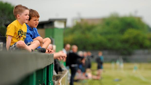 20 June 2015; Two young fans watch the match. GAA Football All-Ireland Senior Championship, Round 1A, London v Cavan, Páirc Smárgaid, Ruislip, London, England. Picture credit: Seb Daly / SPORTSFILE