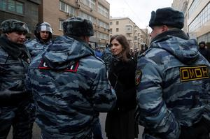 Nadezhda Tolokonnikova, a prominent member of the protest group Pussy Riot, speaks to police officers outside a courthouse in Moscow February 24, 2014