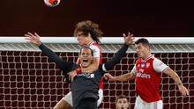Liverpool's Virgil van Dijk in action with Arsenal's David Luiz. Picture: REUTERS / Paul Childs / Pool
