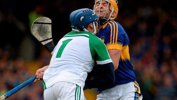 Seamus Callanan, here clashing with Limerick's Barry Hennessy for which he had to leave the pitch for a blood injury, has become a major attacking focus for Tipperary