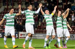 Celtic captain Scott Brown celebrates with team-mates at the end of the William Hill Scottish Cup Fourth Round match at Tynecastle Stadium