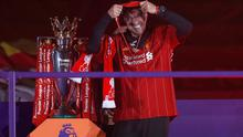 LIVERPOOL, ENGLAND - JULY 22: Jurgen Klopp, Manager of Liverpool celebrates with a Premier League Winner's medal following the Premier League match between Liverpool FC and Chelsea FC at Anfield on July 22, 2020 in Liverpool, England. Football Stadiums around Europe remain empty due to the Coronavirus Pandemic as Government social distancing laws prohibit fans inside venues resulting in all fixtures being played behind closed doors. (Photo by Phil Noble/2020 Pool)