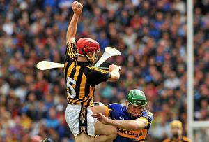 Tommy Walsh wins a puck-out against Noel McGrath during the 2011 All-Ireland SHC final against Tipperary. Picture credit: Barry Cregg / SPORTSFILE
