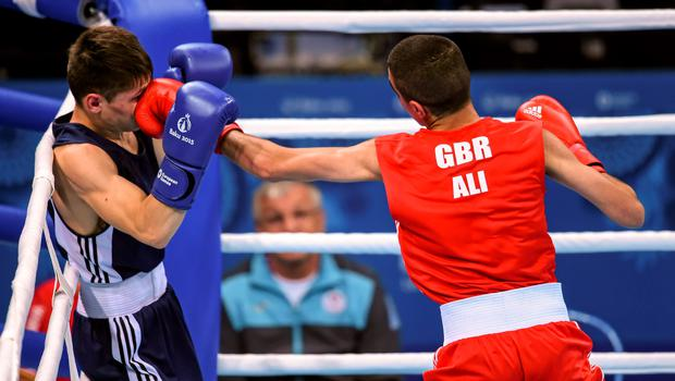 16 June 2015; Muhammad Ali, Great Britain, right, exchanges punches with Alexandr Riscan, Moldova, during their Men's Boxing Fly 52kg Round of 32 bout. 2015 European Games, Crystal Hall, Baku, Azerbaijan. Picture credit: Stephen McCarthy / SPORTSFILE