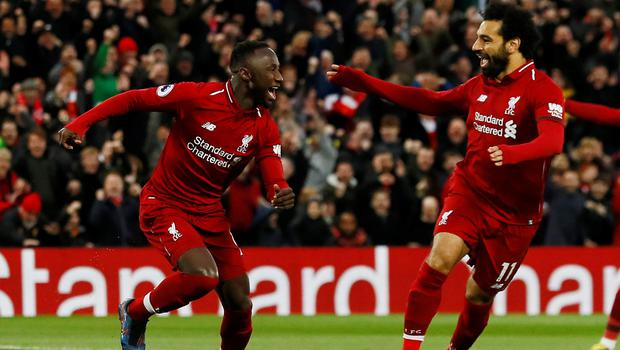 Naby Keita celebrates after scoring the first goal against Huddersfield at Anfield