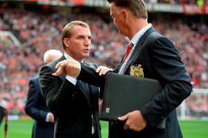 Brendan Rodgers shakes hands with Louis van Gaal ahead of the English Premier League football match between Manchester United and Liverpool at Old Trafford