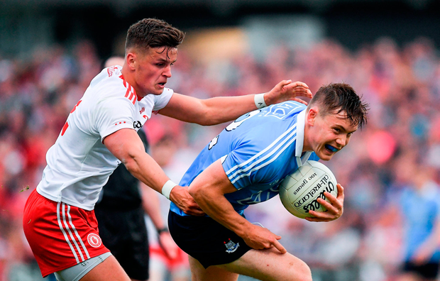 Con O'Callaghan of Dublin in action against Michael McKernan of Tyrone