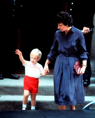 File photo dated 16/09/1984 of Prince William waving to the crowd as he leaves the Lindo Wing of St. Mary's Hospital, London, with his nanny Barbara Barnes, after spending approximately 20 minutes visiting his mother the Princess of Wales and his new-born baby brother Prince Harry.