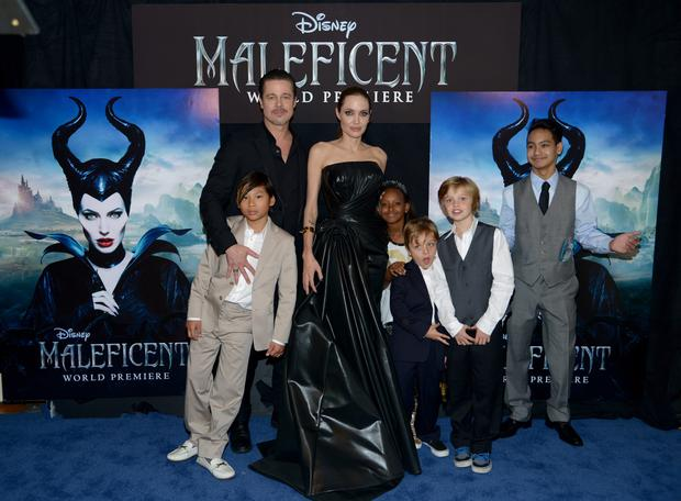 """Actors Brad Pitt and Angelina Jolie (C) with children (L-R) Pax Jolie-Pitt, Zahara Jolie-Pitt, Knox Jolie-Pitt, Shiloh Jolie-Pitt and Maddox Jolie-Pitt attend the World Premiere of Disney's """"Maleficent"""", starring Angelina Jolie, at the El Capitan Theatre on May 28, 2014 in Hollywood, California.  (Photo by Charley Gallay/Getty Images for Disney)"""