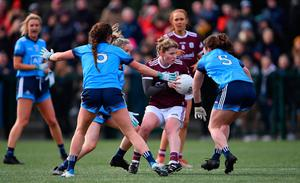 Lucy Hannon of Galway in action against Dublin players, from left, Leah Caffrey, Caoimhe O'Connor, and Niamh Collins