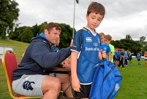 Mike Ross signs an autograph for Sam Dignal, Dublin, during the Herald Leinster Rugby Summer Camps in De La Salle Palmerston RFC, Kilternan, Co. Dublin. Picture credit: Pat Murphy / SPORTSFILE