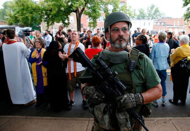 A white supremacist militia member armed an assault rifle in Charlottesville. Photo: REUTERS/Joshua Roberts