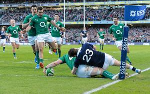 2 February 2014; Ireland's Jamie Heaslip steps into touch as he touches the ball down for a disallowed try under pressure from Scotland's Max Evans. RBS Six Nations Rugby Championship, Ireland v Scotland, Aviva Stadium, Lansdowne Road, Dublin. Picture credit: Brendan Moran / SPORTSFILE