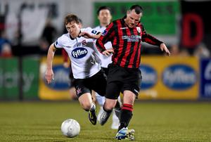 Pat Flynn, Longford Town, in action against David McMillan, Dundalk