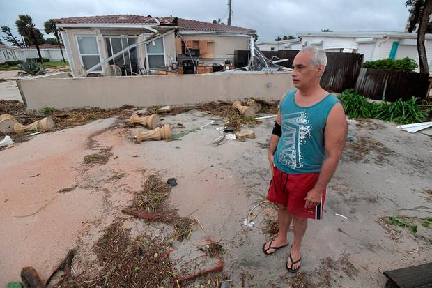 Homeowner Joe Lovece stands on what had been the back patio of his oceanfront home after the eye of Hurricane Matthew passed Ormond Beach, Florida. Photo: Reuters