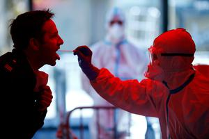 Testing time: A medical employee collects a smear at a test centre for public service workers in Cologne. Picture: Reuters