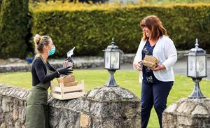 Kaitlin McMahon from Johnnie Fox's pub in Glencullen delivers food to Patricia Fitzachary Picture; Gerry Mooney