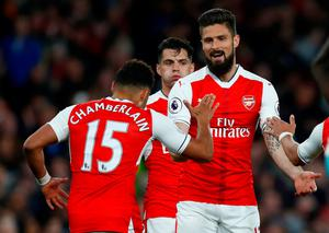 Arsenal's Olivier Giroud celebrates scoring their third goal with Alex Oxlade-Chamberlain