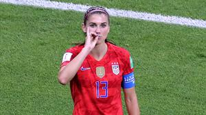USA attacker Alex Morgan celebrates her goal against England in the FIFA Women's World Cup semi-final by pretending to drink a cup of tea. Photo: Getty