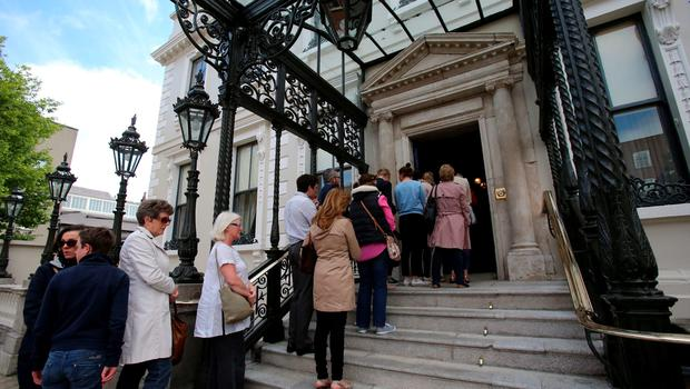 Members of the public queue to sign a book of condolence at Mansion House in Dublin for those killed in the Berkeley balcony collapse. Niall Carson/PA Wire