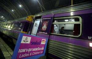 A female railway police officer checks the train carriages for women and children, at Hua Lamphong train station in Bangkok, Thailand, The State Railway of Thailand introduced a womens-only carriage on main routes for overnight trains following the rape and murder of a 13-year-old girl on an overnight train in July
