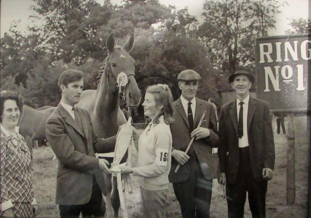 The Costello family of Dunamaggin receiving their prize from Dan Kiely for winning the Iverk young horse championship 1960