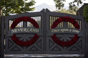 LOS OLIVOS, SANTA YNEZ VALLEY, SANTA BARBARA COUNTY, CA - 2009:  The gates to singer Michael Jackson's Neverland Ranch have been turned into a memorial as seen in this 2009 Los Olivos, Santa Barbara County, California, early morning summer photo. (Photo by George Rose/Getty Images)