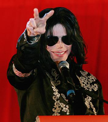 TO GO WITH AFP DOUNIAMAG STORY US popstar Michael Jackson addresses a press conference at the O2 arena in London, on March 5, 2009. Pop megastar Michael Jackson announced Thursday he will play a series of comeback concerts in London in July, his first major shows for over a decade. Four years after his infamous child abuse trial, the 50-year-old eccentric singer confirmed he will play 10 gigs at the giant London O2 arena starting on July 8. AFP PHOTO/Carl de Souza (Photo credit should read CARL DE SOUZA/AFP/Getty Images)