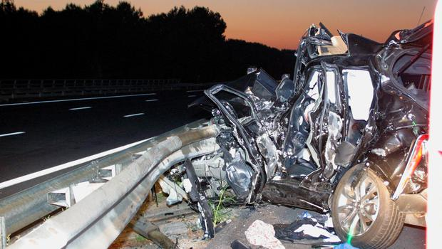 The wreckage of car belonging to rugby player Jerry Collins is pictured in the highway near Beziers, southern France, Friday, June 5, 2015. Former All Blacks flanker Jerry Collins and his partner died after their car was struck by a bus at a highway toll booth outside the southern French town of Beziers on Friday. (AP Photo/Jean-Pierre Amarger)