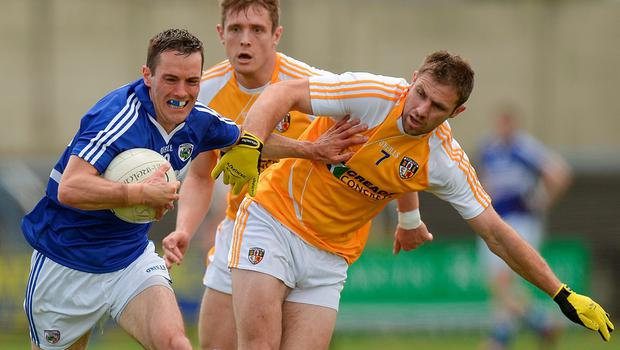 Niall Donoher shrugs off a challenge from Antrim's Tony Scullion